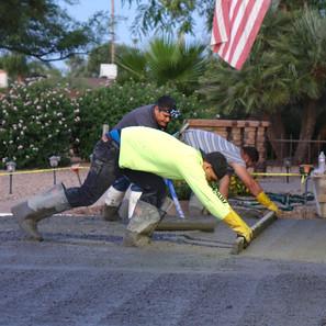 Pour and screeding concrete