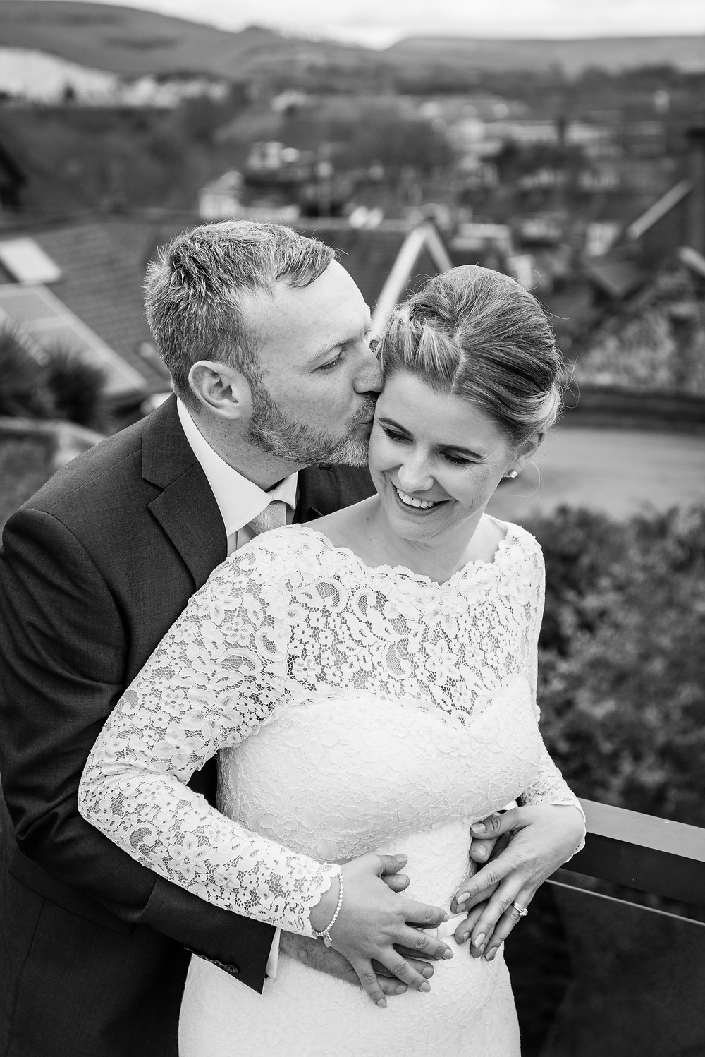 bride and groom embrace, black and white weddinh photograph