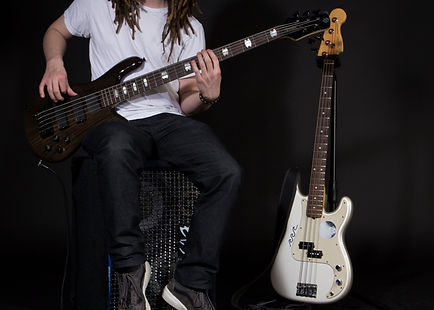 Craig Stoddart professional portrait with bass guitar
