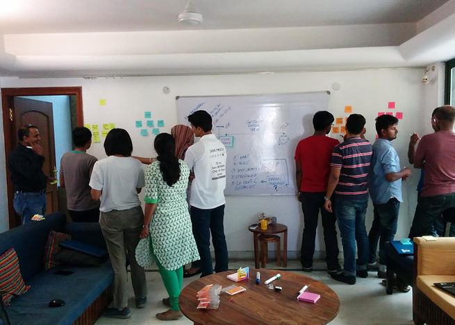 Coworkers preparing before a Design Sprint facilitated by Google India