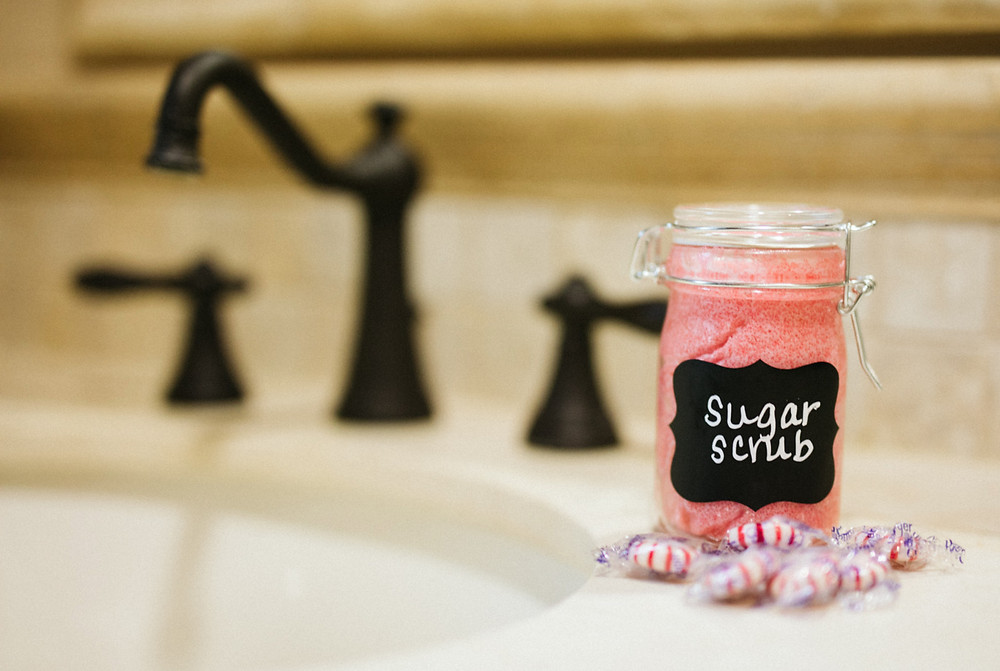 Jar of pink sugar scrub next to a faucet, 50, Fabulous & Finally Free