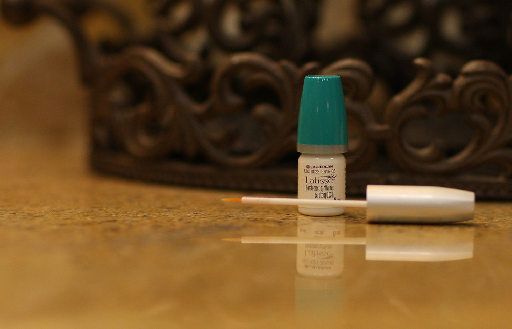 Latisse and applicator on a counter, 50, Fabulous & Finally Free