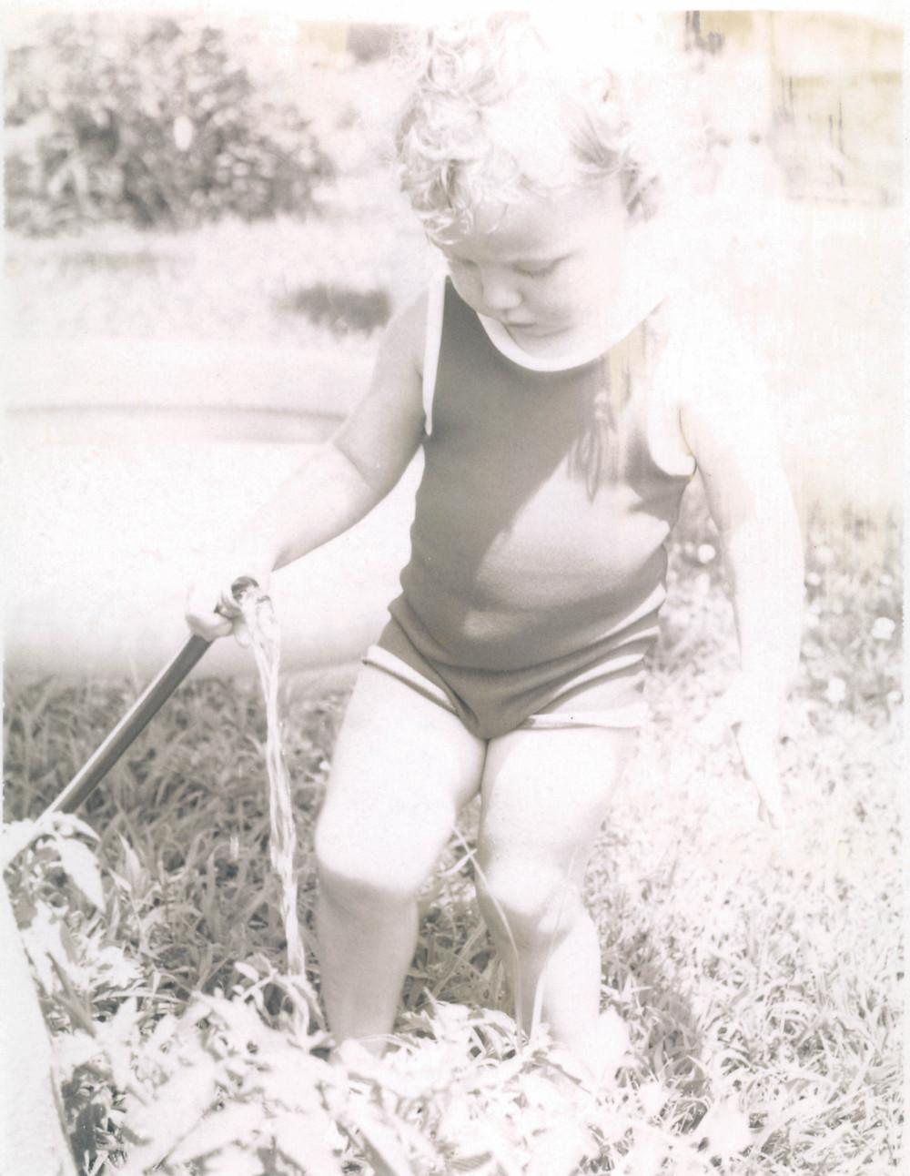 Little girl holding a hose FF&FF