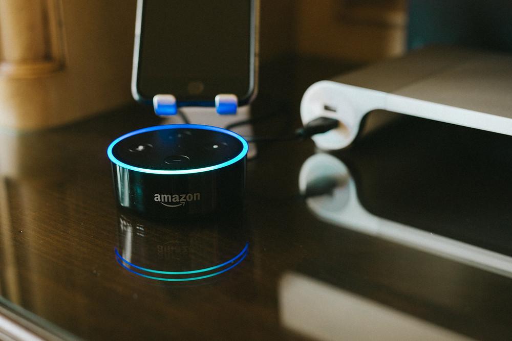 Alexa Dot on a desk, 50, Fabulous and finally free.com
