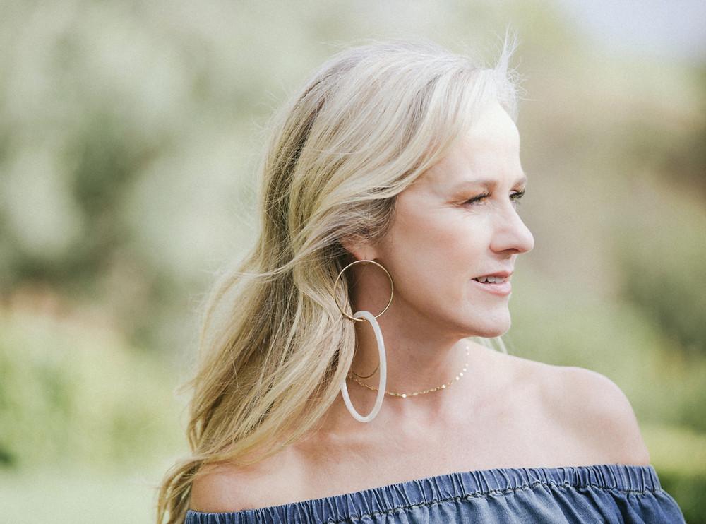 Women with large earrings, 50, fabulous & finally free.com