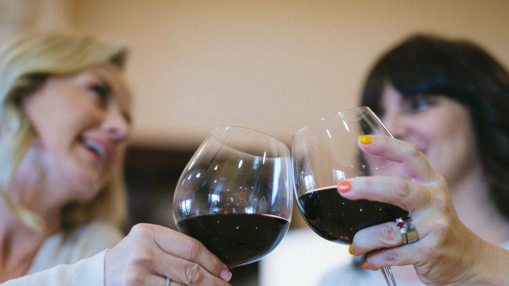 Two women drinking wine, 50, fabulous & finally free.com
