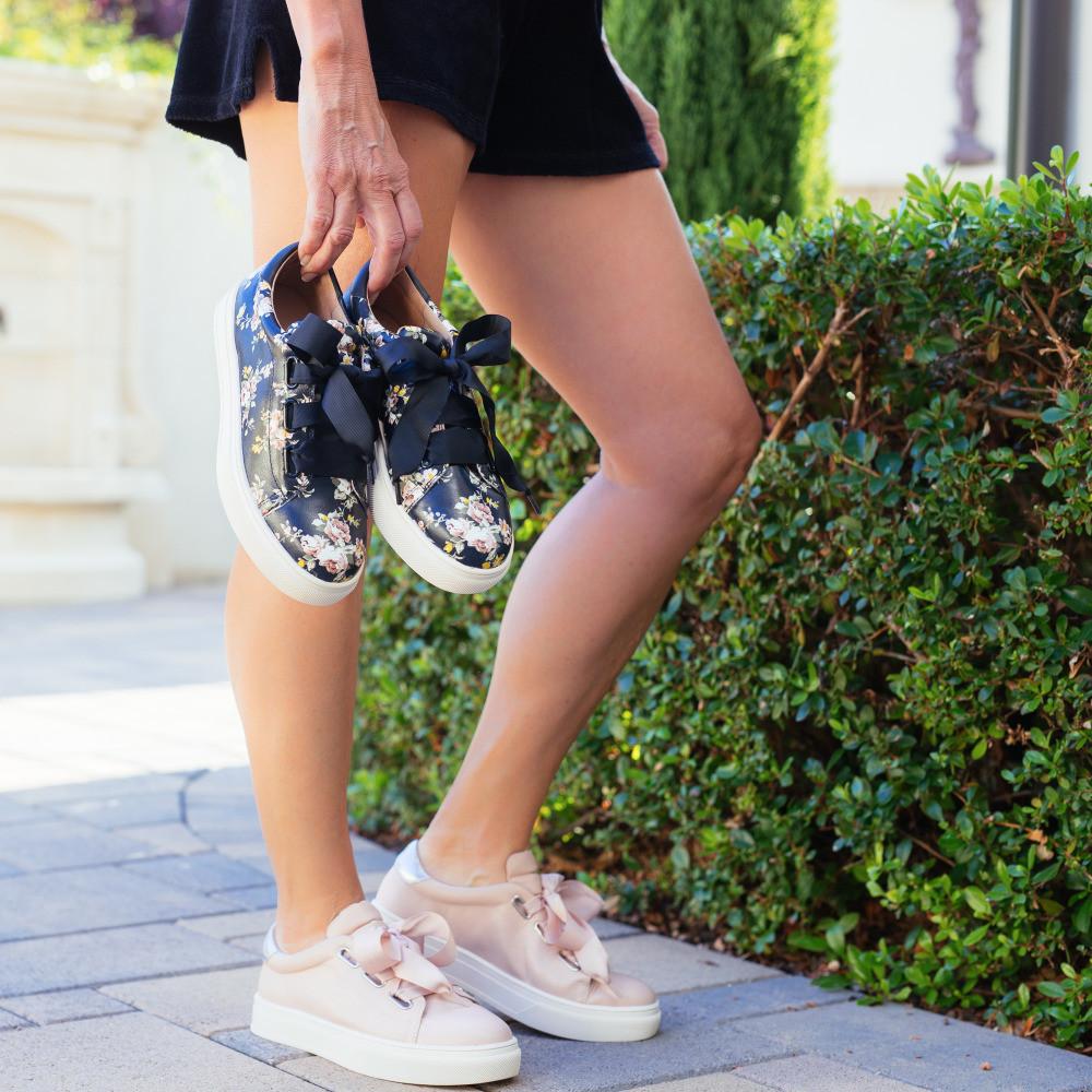 Women's legs wearing tennis shoes. 50, fabulous & finally free.com
