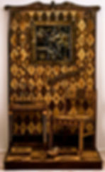 carved wood walll, floor, table, chair, carve painted tarpaper and assemblage
