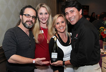 Owners and Staff pouring wines at a charity event