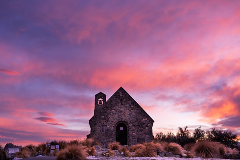 lake tekapo church pink sky