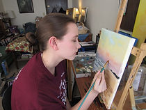 Rachel Wheele fine artist painting at her easel