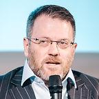 Greg Speaking.jpg