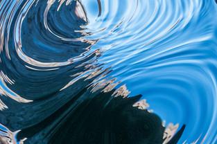 WATER FLOWING UNDER DAM