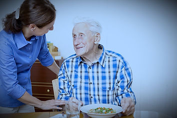 Piedmont Health Care Center resident being served a nutritious meal