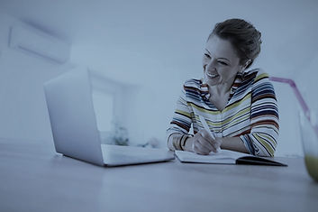 Happy woman taking a virtual training course