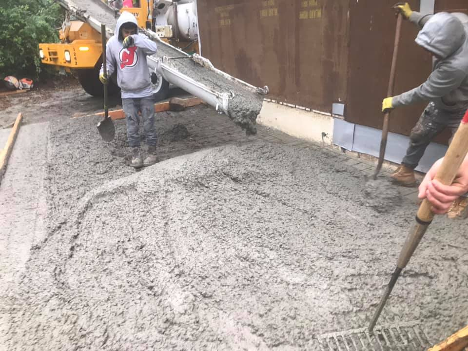 Pouring concrete for garage floor.
