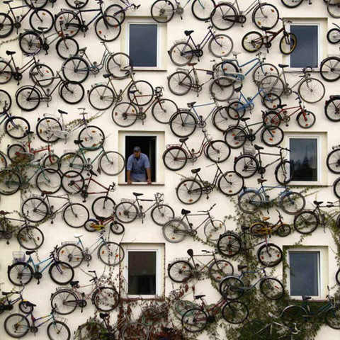 bicycles on a building wall