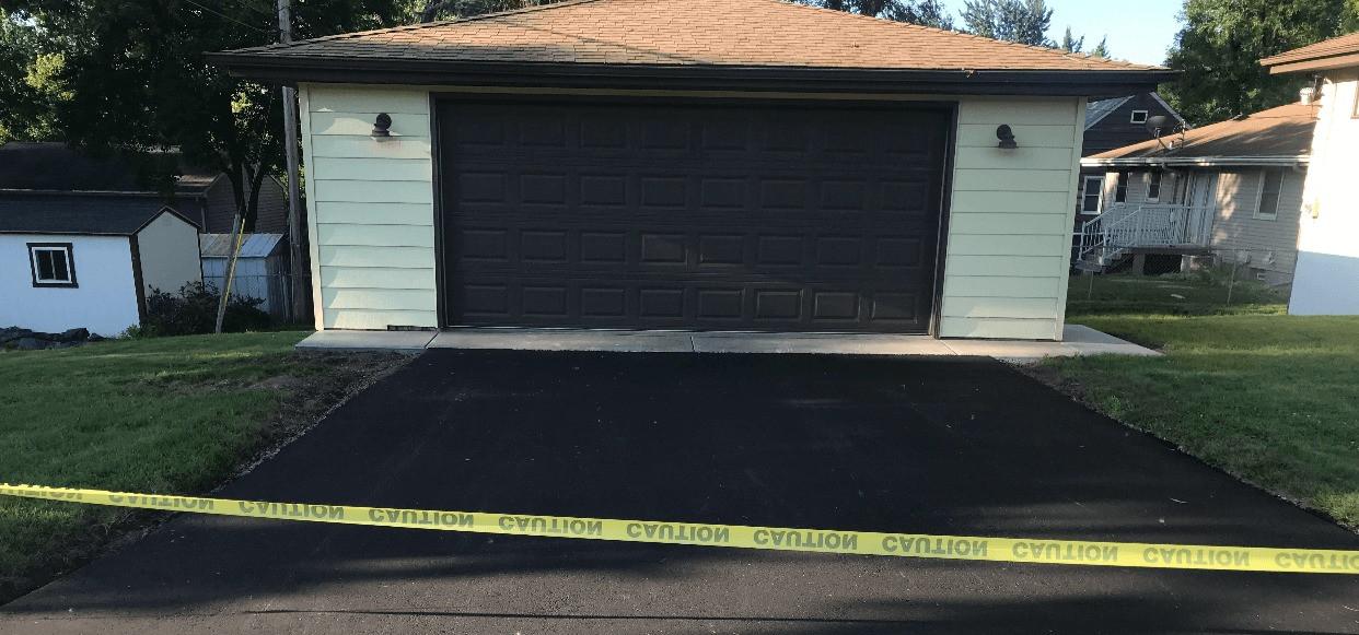 Asphalt driveway to garage