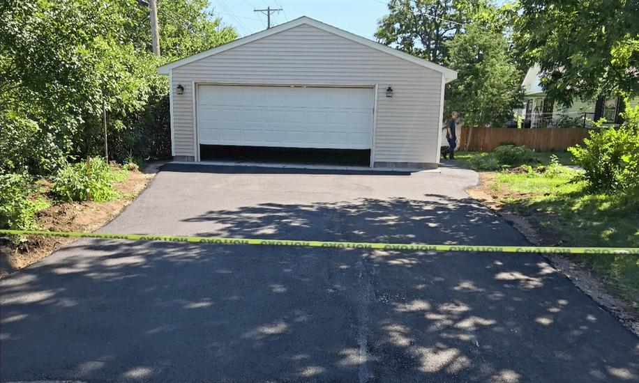 New asphalt driveway to garage entrance