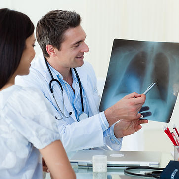 Doctors analyzing an x-ray in a meting.j