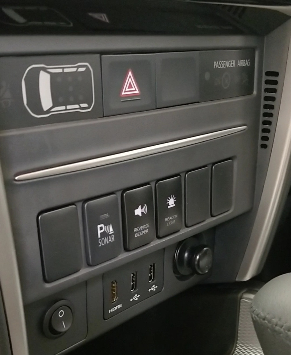 OE Factory Style Switches mounted on the centre console of the dash on 2020 Mitsubishi Triton GLX-R