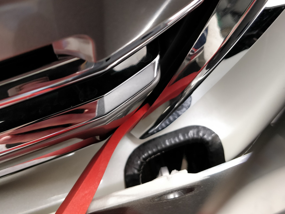 Plastic tool prying open chrome plastic trim