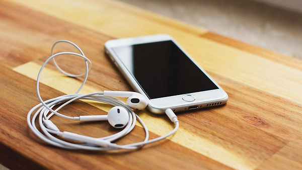 White-iphone-headphones-attached-to-an-a