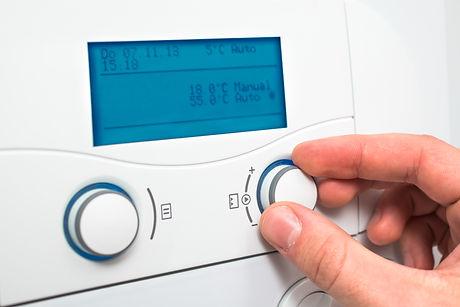 Man changing heating temperature