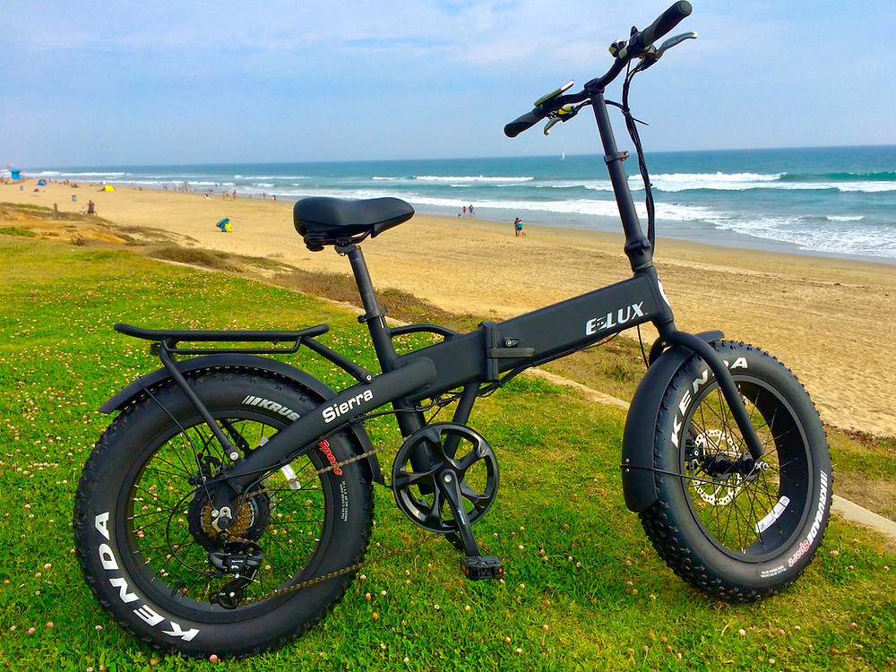 An image of the E Lux Sierra Electric Bike model on the beach
