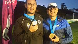 Gold Medalist ( doubles)/ Bronze ( Singles)