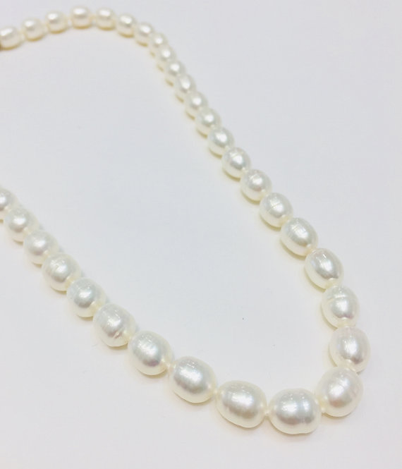 Freshwater 10x7mm Pearls, 18 inches.