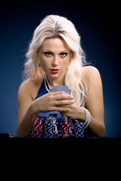 9879334-young-a-woman-playing-poker.jpg