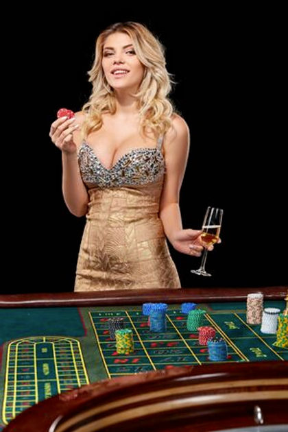 66402616-woman-in-a-smart-dress-plays-roulette-addiction-to-gambling-holding-in-the-hands-