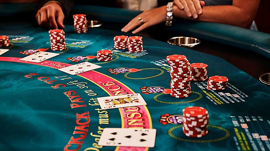 blackjack-table-card-game-players-and-chips-onboard-things-to-do-casino.jpg