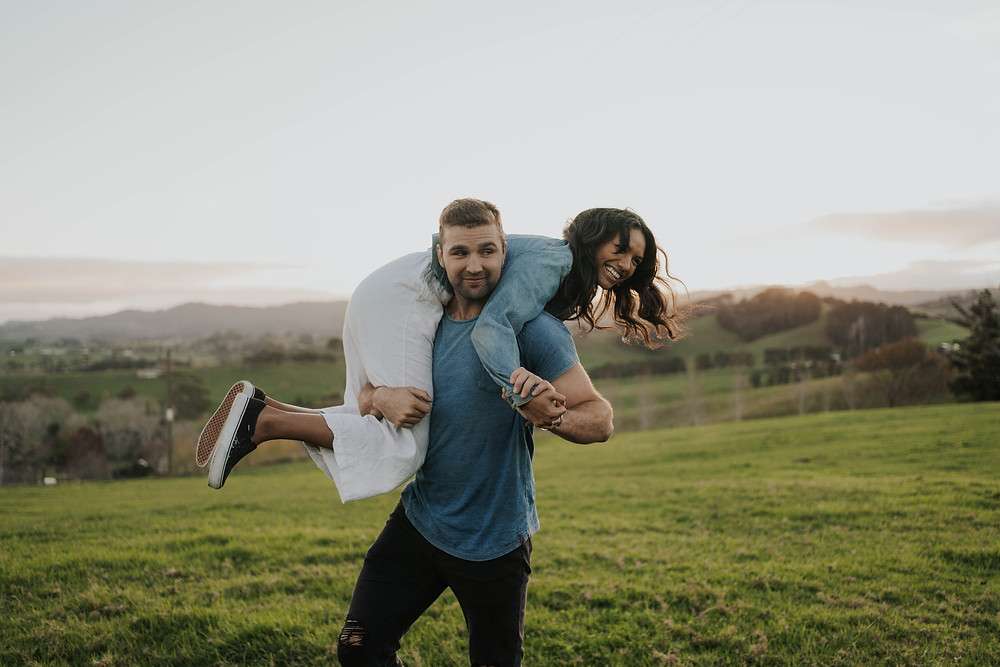 Man lifting woman at engagement shoot