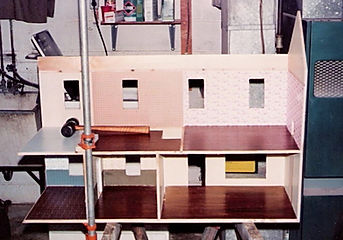 WRR building the dollhouse for his mothe