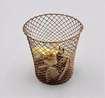 wastebasket with trash.jpg