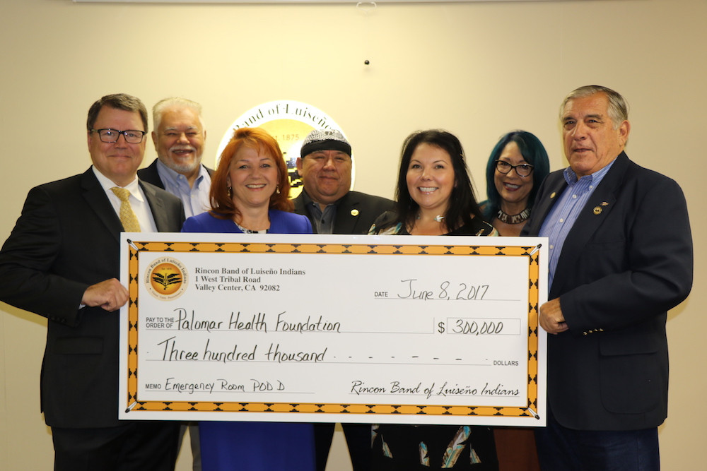 """he Rincon Band of Luiseño Indians has committed $300,000 to the Palomar Health Foundation capital campaign to fund expansion of emergency services at Palomar Medical Center Escondido.  Specifically, these funds will go toward building out Pod D, the unfinished shell space inside the Emergency Department that will feature new patient treatment rooms, with state-of-the-art medical beds, monitors, technology, and lifesaving equipment, along with additional clinical support space. According to Bo Mazzetti, Rincon chairman, this is not the Band's first contribution to the Palomar Health Foundation. However, it is the first to the Emergency Department expansion campaign. """"When considering how to make our donations meaningful to the North County, we wanted to make an investment that benefits as many people as possible,"""" said Mazzetti. """"A contribution to meet increased emergency capacity at Palomar Medical Center Escondido was an obvious solution because at some time almost everyone is likely to need emergency care either for themselves or for family."""" """"Convenience, skill, and timing is important to saving lives in a serious emergency,"""" Mazzetti said.  """"Rincon members, like others in North County, look to Palomar Medical Center Escondido for our care and we believe it is important to support the Foundation's goal to provide the highest level of treatment."""" According to Dr. Jaime Rivas, Emergency Services Medical Director at Palomar Health, the Emergency Department sees an average of about 300 patients per day and expects that number to climb in the future. The Emergency Department currently has 52 licensed beds increasing to 66 once Pod D is completed by the end of this year. """"One of the many benefits from the increased capacity will be to allow the entire treatment team to better experience the joy of medicine,"""" Dr.  Rivas said. """"Happier doctors will translate to better care and overall satisfaction for patients."""" Dr. Rivas added that he expects wait times to decrease in t"""