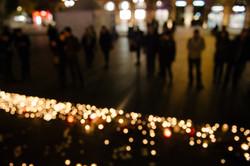 Defocused view of people attend a vigil