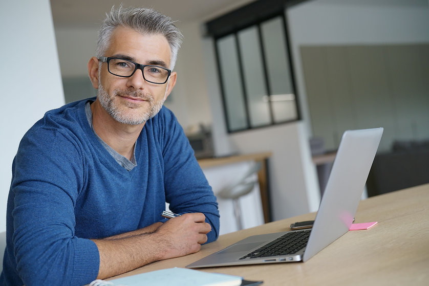 Middle-aged man working from home-office