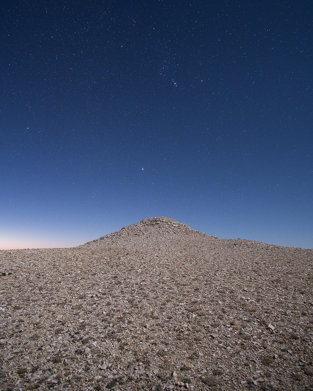 Moonlit White Mountains California with the Orion Constellation.