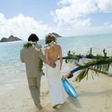 """""""Two years to the June full moon after Seana, barefoot and newly wedded, we stepped directly from our Lanikai Beach ceremony into a Hawaiian outrigger canoe."""""""