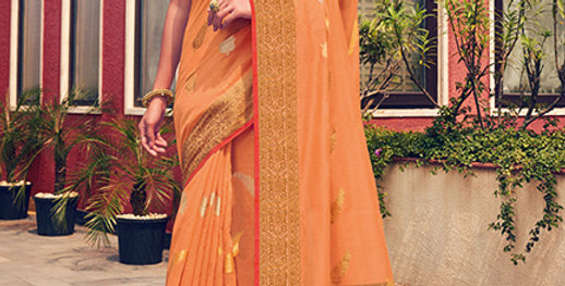 A Pretty Traditional Look  Light Orange Color Paired With Orange Colored blouse