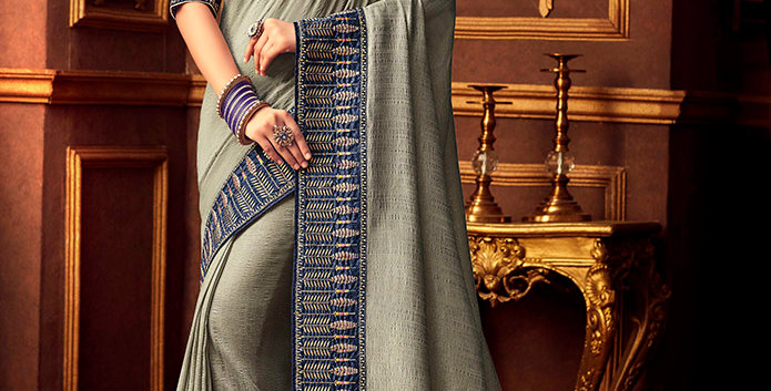 Beautiful Designer Saree In Grey Color Paired With Navy Blue Colored Blouse