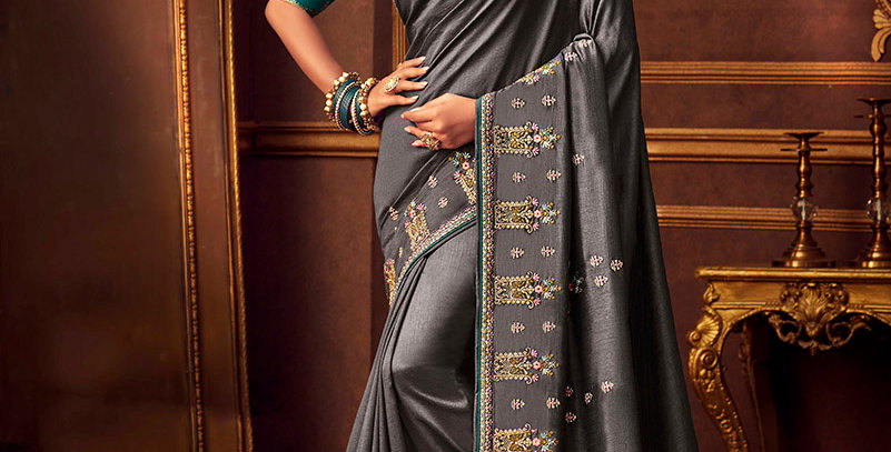 Beautiful Designer Saree In Dark Grey Color Paired With Blue Colored Blouse