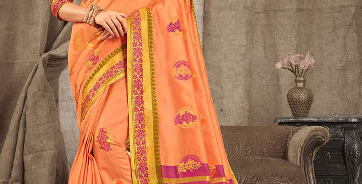 A Pretty Traditional Dark Peach Color Paired With Magenta Pink Colored blouse