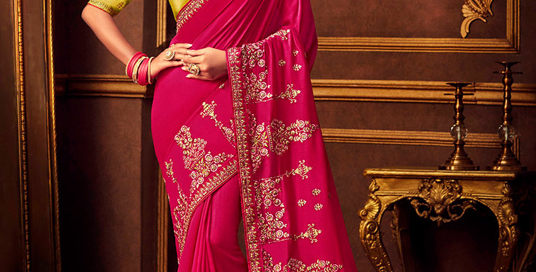Beautiful Designer Saree In Dark Pink Color Paired With Yellow Colored Blouse