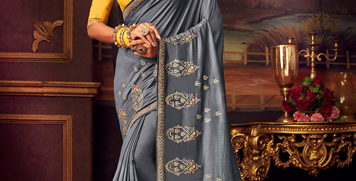 Beautiful Designer Saree In  Grey Color Paired With Yellow Colored Blouse