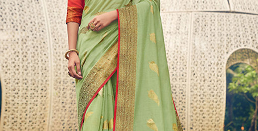 A Pretty Traditional Look  Light Green Color Paired With   Orange Colored blouse