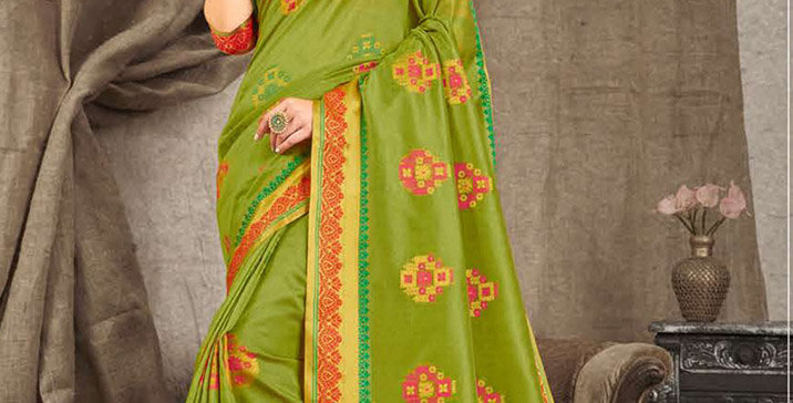 A Pretty Traditional Green Color Paired With Contrasting Red Colored blouse